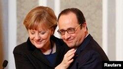 Канцлер Германии Ангела Меркель и президент Франции Франсуа Олланд после завершения переговоров по Украине в Минске. 12 февраля 2015 года.