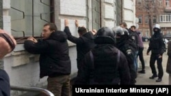 Police detain far-right activists in Kyiv on February 9.