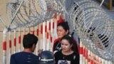 Азия: отставка правительства в России и права человека в Китае