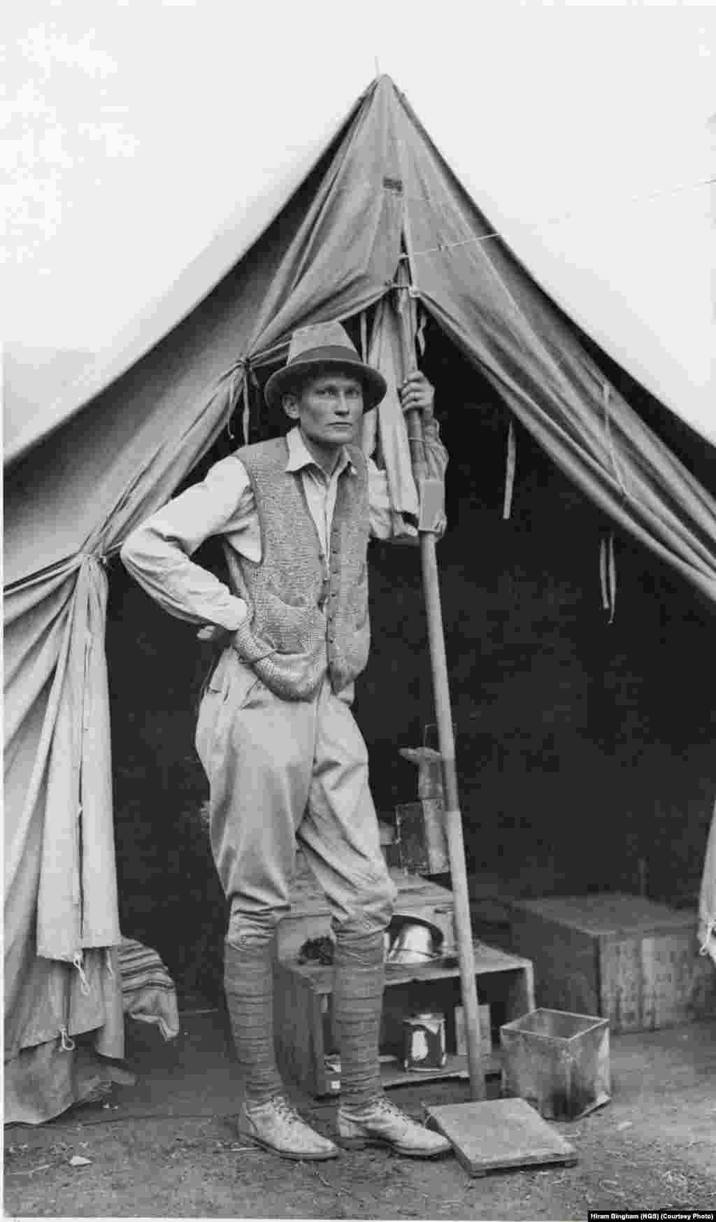 Hiram Bingham poses for an informal picture in front of his tent at Machu Picchu, the lost mountaintop city of the Inca in the Peruvian Andes. National Geographic supported Bingham's excavations at the site from 1912 to 1915.