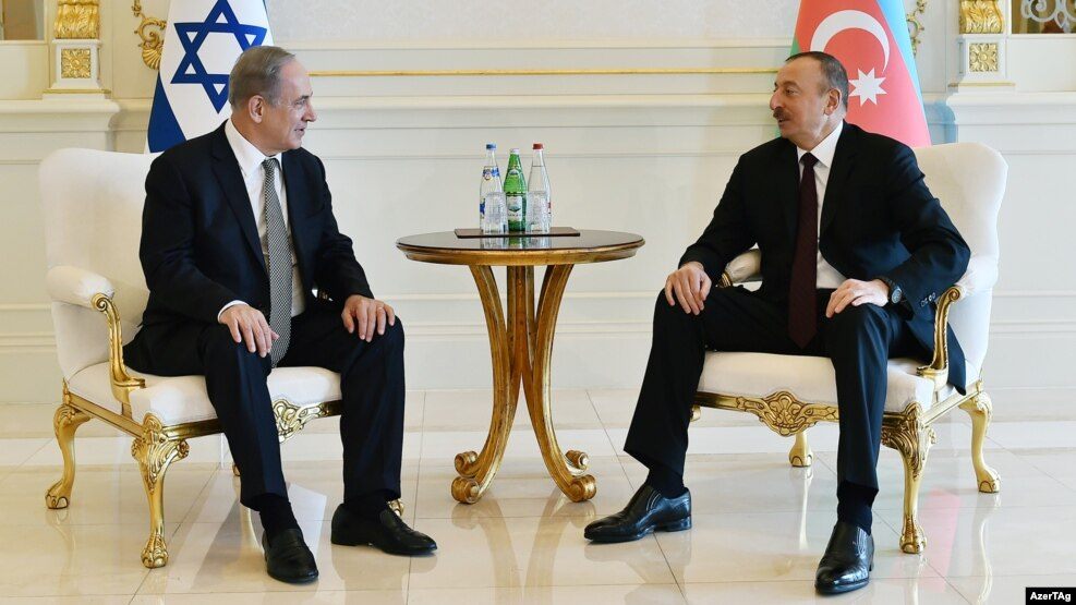 Azerbaijani President Ilham Aliyev (right) meets with Prime Minister of Israel Benjamin Netanyahu in Baku on December 13.