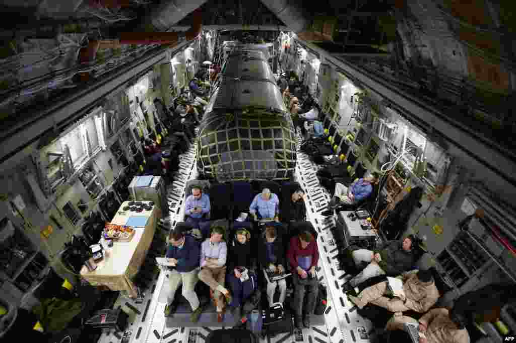 "The ""Silver Bullet"" airstream trailer (center) carrying U.S. Secretary of Defense Chuck Hagel is pictured inside a U.S. Air Force C-17 aircraft transporting him and his staff from Kabul to Ramstein air base in Germany. (AFP/Jason Reed)"
