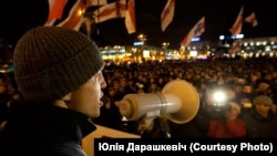 "Young Front leader Dzmitry Dashkevich addresses an opposition crowd during a ""Go away!"" campaign in 2010."