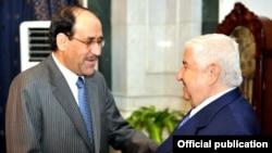 رئيس الوزراء العراقي نوري المالكي يستقبل وزير الخارجية السوري وليد المعلم