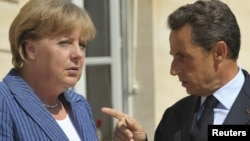 German Chancellor Angela Merkel (left) and French President Nicolas Sarkozy have been helping draft a plan to boost the eurozone rescue fund.