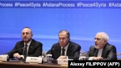 Russian Foreign Minister Sergei Lavrov (center), Iranian Foreign Minister Mohammad Javad Zarif (right) and Turkish Foreign Minister Mevlut Cavusoglu at an earlier round of Syria peace talks in Astana in March. (file photo)