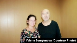 Aron Atabek (right) poses with human rights activist Yelena Semenova, who visited him in prison in Pavlodar in July 2019.