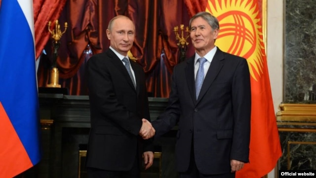 Russia's Vladimir Putin (left) and Kyrgyzstan's Almazbek Atambaev meeting in December 2013