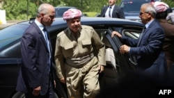 Kurdish leader Masud Barzani (center) has kept up a barrage of public statements suggesting the Kurdish region is now ready to move swiftly toward statehood. But is it?