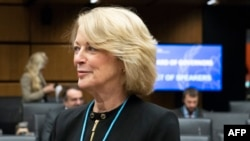 File - US representative to the International Atomic Energy Agency (IAEA), Jackie Wolcott arrives to part in a meeting of IAEA Board of Governors on November 22, 2018