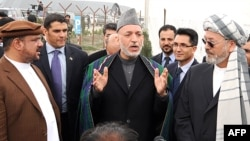 Hamid Karzai (center) with Mohammad Qasim Fahim (left) and Karim Khalili in Kabul on May 4