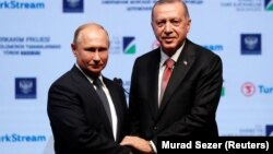 "Russian President Vladimir Putin (left) and Turkish leader Recep Tayyip Erdogan plan to meet again ""soon."""