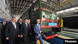 Armenia - Vladimir Yakunin (L), chief of Russia's state railway, and Prime Minister Tigran Sarkisian inaugurate a new rail depot in Gyumri, 28May2013.