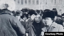 Pro-democracy leader Sanjaasuren Zorig (center, with glasses) and Tsakhiagiin Elbegdorj, the current president of Mongolia, standing on Ulan Bator's central Sukhbaatar Square during the 1990 demonstrations.