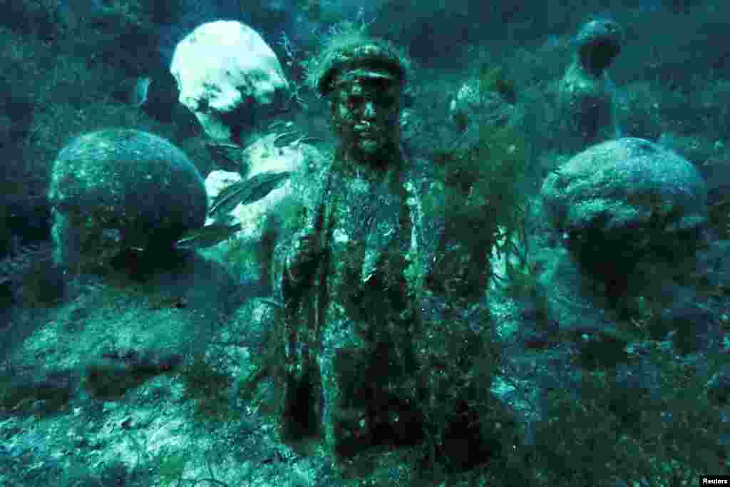 A sculpture of Vladimir Lenin caked in algae. The Alley Of Leaders, as the underwater site is called, began on August 25, 1992, when diving instructor Vladimir Borumenskiy lowered the first bust under the water.