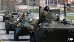 Russian armored vehicles on the road between Simferopol and Sevastopol, in Ukraine's Crimea, on March 17