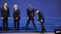 Presidents Ilham Aliyev, Nursultan Nazarbaev, Barack Obama and Lee Myung-Bak find their places for the group photo; 2012 Nuclear Security Summit in Seoul