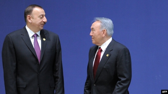 Azerbaijani President Ilham Aliyev (left) and his Kazakh counterpart, Nursultan Nazarbaev, are two leaders of Turkic-speaking, former Soviet nations who will be nervously monitoring relations between Moscow and Ankara in the coming months.
