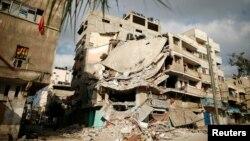 Газадағы әуе соққысынан қираған тұрғын үй. 19 шілде 2014 жыл.