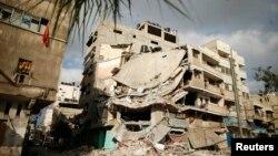 Будинок у місті Газа, зруйнований повітряним ударом у п'ятницю, фото 19 липня 2014 року