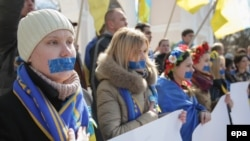 Ukrainians stand with taped mouths during their rally in Simferopol, Crimea.