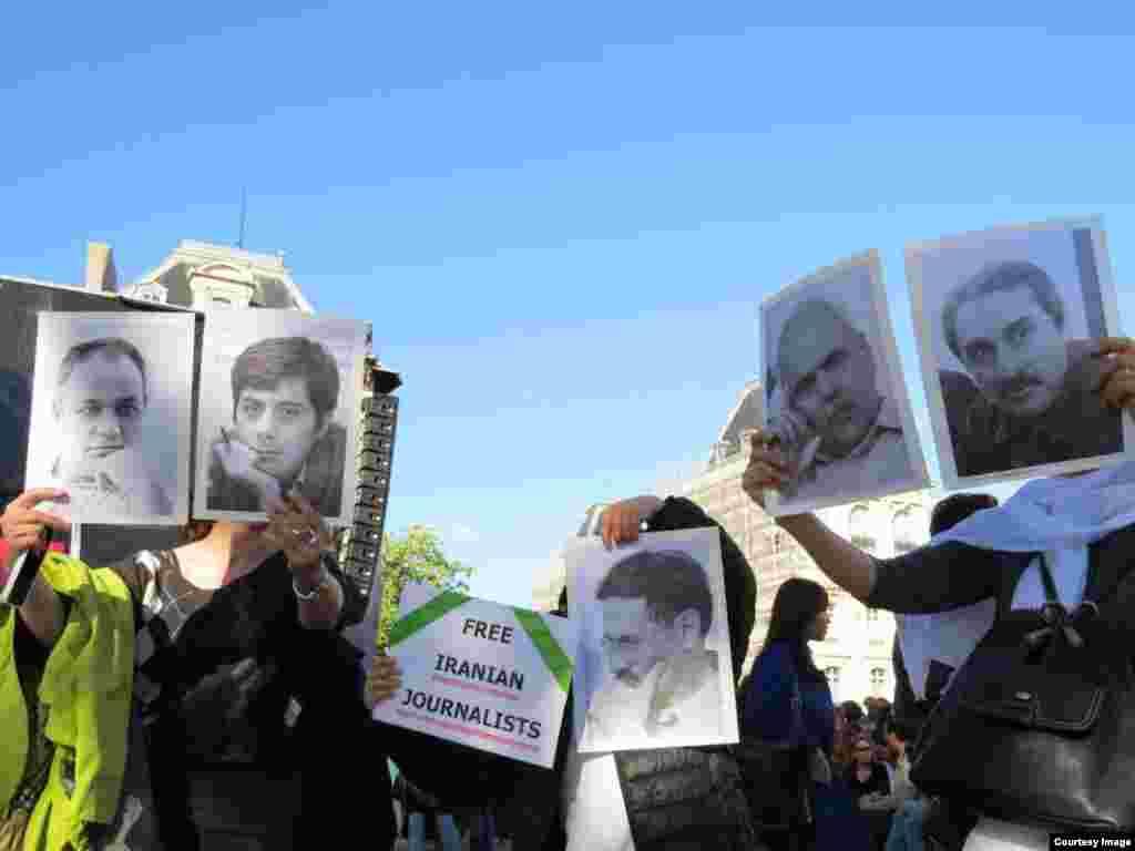 عکس خبرنگاران زندانی در ایران در دست برخی از شرکت کنندگان در «کنسرتی برای آزادی» در پاریس