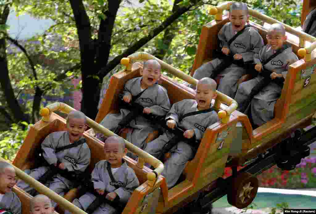 Boys who are experiencing the lives of Buddhist monks by staying in a temple for two weeks as novice monks enjoy a ride at Everland amusement park in Yongin, South Korea. (Reuters/Kim Hong-Ji)