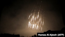A photo shows what appears to be white phosphorus incendiaries landing during regime bombardment in Douma, one of the few remaining rebel-held pockets in Eastern Ghouta on the outskirts of the capital Damascus, March 23, 2018