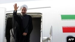 Iranian President Hassan Rohani waves before departing for the United States to attend the UN General Assembly on September 23