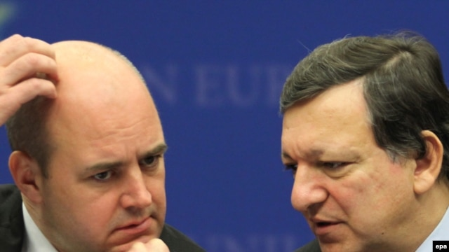 As Swedish Prime Minister Fredrik Reinfeldt (left) hosts the meeting where the EU will pick its first president, European Commission President Jose Manuel Barroso looks forward to sharing a podium with another president.