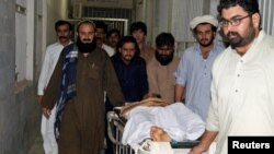 People move a stretcher with an injured man, who was shot after militants attacked a rally organized by the PTM in Wana, at a hospital in Dera Ismail Khan, on June 4.