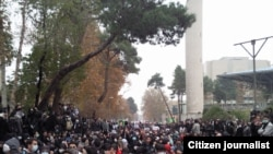 Opposition supporters demonstrate at Tehran University on December 8