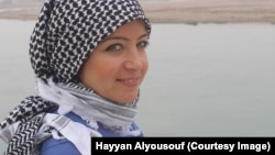IWPR Senior Journalist and Syria Coordinator Zaina Erhaim along the Euphrates River in Syria before ISIS occupation. Photo by Hayyan Alyousouf.
