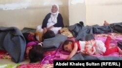 """Беженки-езидки, которым удалось вырваться из района наступления боевиков """"Исламского государства"""". Дохук, 17 февраля 2015 года."""