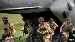 British soldiers exit a Merlin helicopter during a British and Afghan National Army joint patrol during recent exercises.