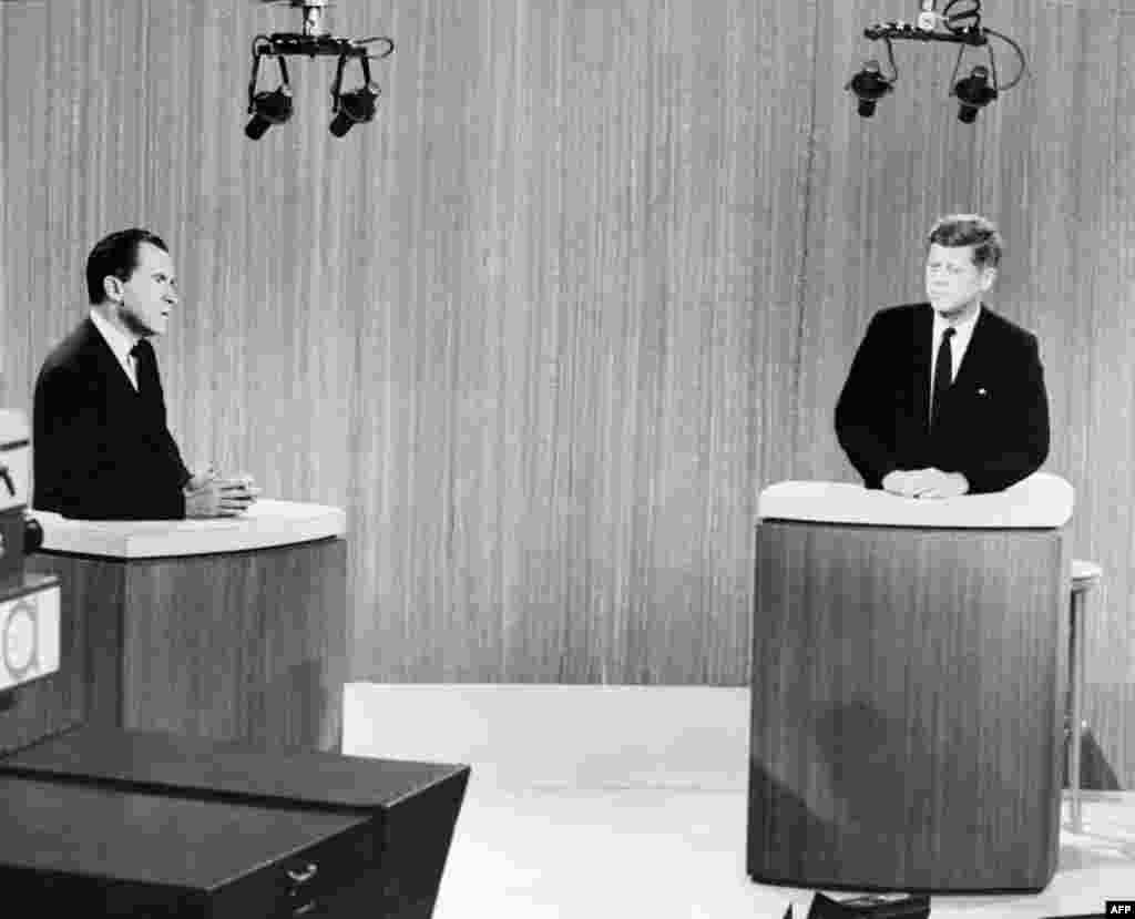 The Republican Party nominee, U.S. Vice President Richard Nixon, and his Democratic challenger, U.S. Senator John Kennedy, discuss their differences in the first nationally televised debate between presidential candidates, in a Chicago television studio, on September 26, 1960.