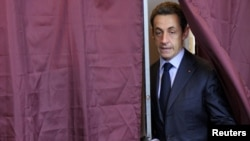 French President Nicolas Sarkozy leaves a Paris polling booth on March 21.