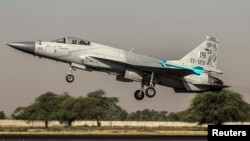 FILE: A Pakistan Air Force jet takes off in 2013.