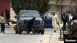 Libya -- Rebel fighters hold guns in Ajdabiyah, 15Mar2011