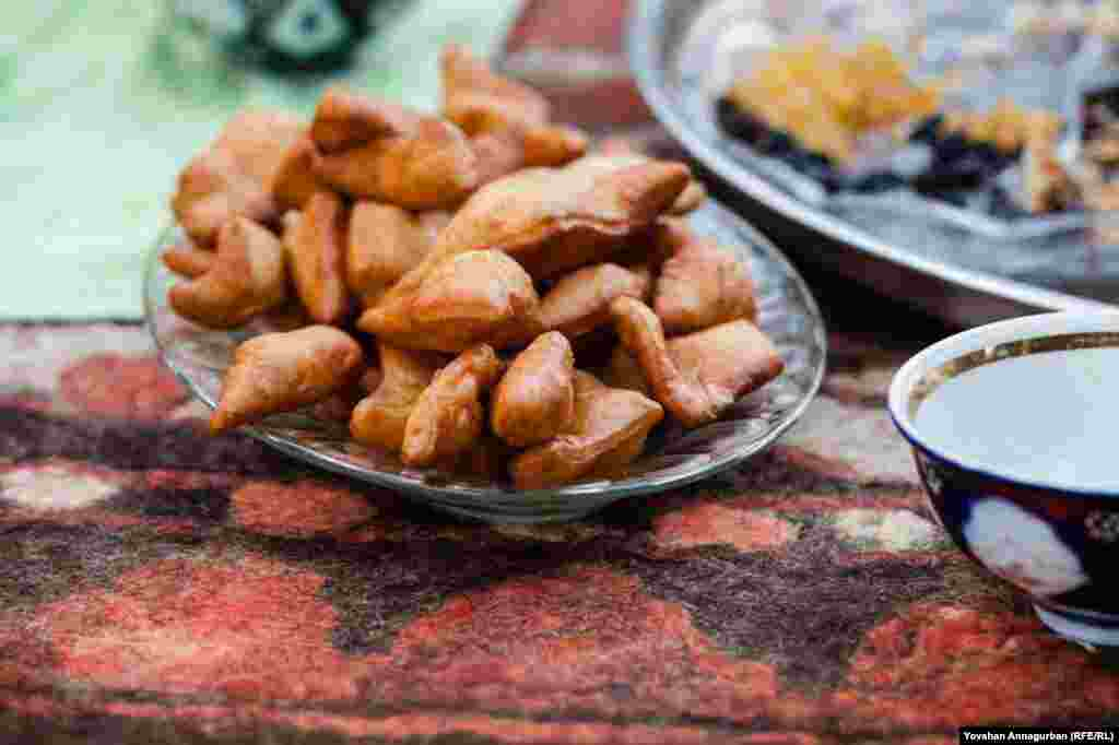 """A platter of """"pishme,"""" or fried yeasted dough, a traditional Turkmen snack that is served with green tea during celebrations and family meals."""