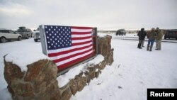 U.S. -- A US flag covers a sign at the entrance of the Malheur National Wildlife Refuge near Burns, Oregon, January 3, 2016