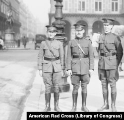 "American photographer Lewis Hine (left) with other members of a U.S. Red Cross expedition in November 1918 before they set off on a yearslong assignment to make ""a survey of actual needs existing in the various countries where the American Red Cross is engaged."""