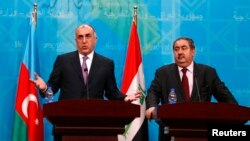 Azerbaijani Foreign Minister Elmar Mammadyarov (left) speaks during a joint news conference with Iraqi counterpart Hoshyar Zebari in Baghdad on February 10.