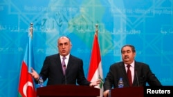 Iraq -- Azerbaijan's Foreign Minister Elmar Mammadyarov speaks during a joint news conference with Iraq's Foreign Minister Hoshyar Zebari (R) in Baghdad, February 10, 2014