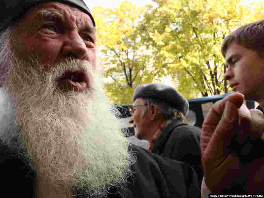 An Orthodox priest protests in front of the Ukrainian parliament against a   language reform bill   that some say would boost the status of the Russian language at the expense of Ukrainian. Photo by Andriy Bashtovyy