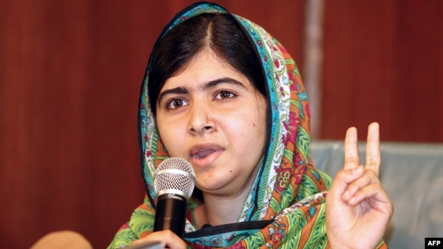 Pakistani education activist Malala Yousafzai gives a press conference after meeting with the Nigerian president in Abuja on July 14.