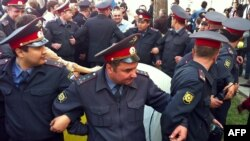 Russian police cordon off activists in Astrakhan on April 10.