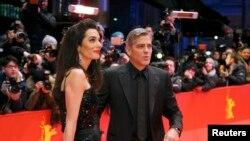 جورج کلونی به همراه همسرش