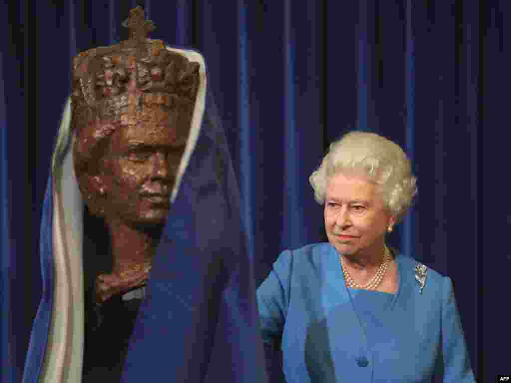 Queen Elizabeth II unveils a portrait bust by sculptor Oscar Nemon at the House of Lords in London in October 2009.