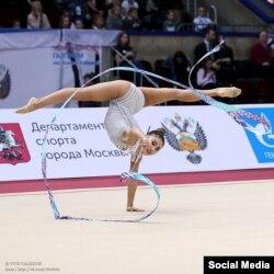 Айша Изабекова.